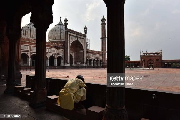 Man performs wuzu in the deserted Jama Masjid complex with authorities comtemplating closing it to the public due to rising coronavirus cases on June...