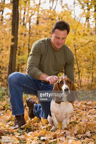 Man petting dog outdoors