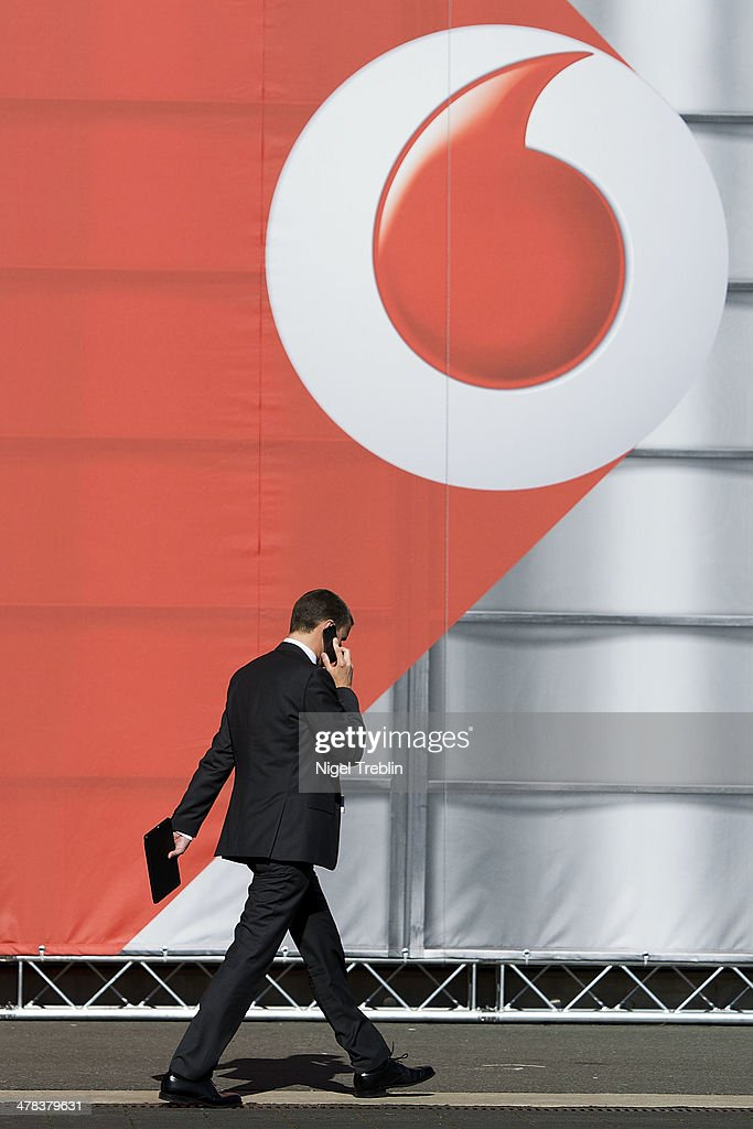 A man phones in front of the Vodafone pavilion at the 2014 CeBIT technology Trade fair on March 13, 2014 in Hanover, Germany. CeBIT is the world's largest technology fair and this year's partner nation is Great Britain.