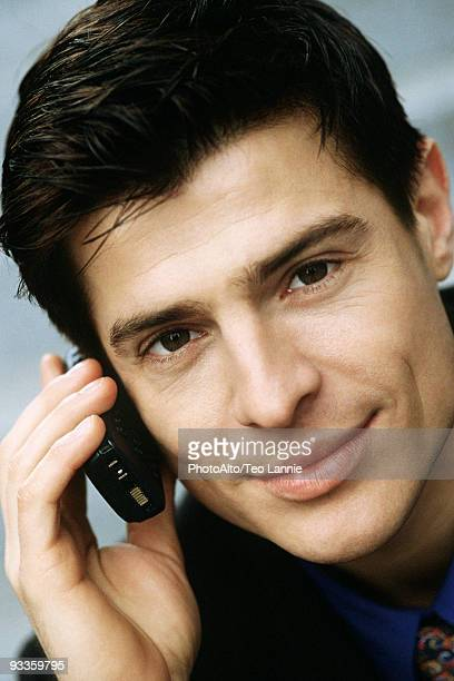 Man phoning using cell phone, portrait