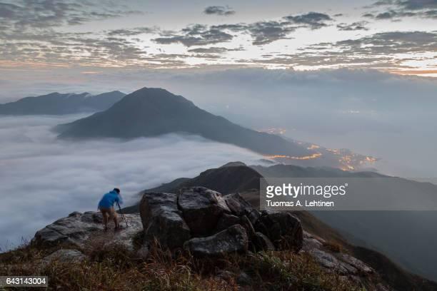 Man photographing at the Lantau Peak at dawn