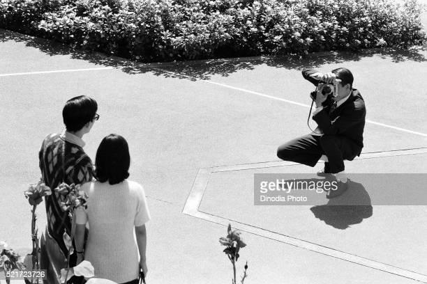 Man photographing couple Edinburgh Place Central, Hong Kong, Asia, 1971