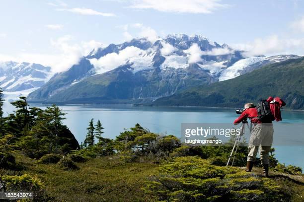 man photographing hobby alaska