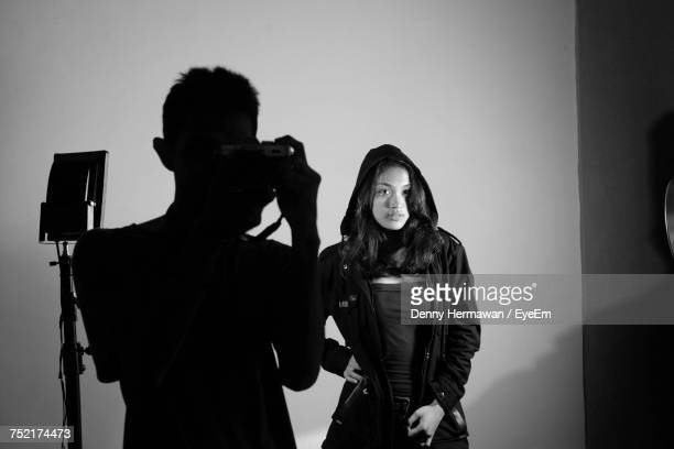Man Photographing Model With Camera
