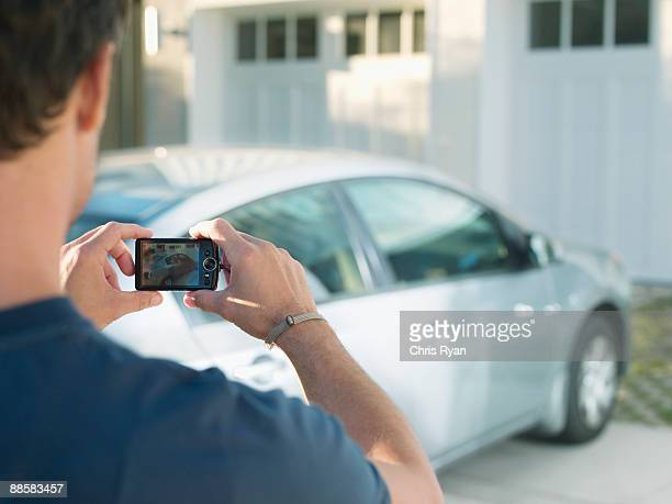 Man photographing new car