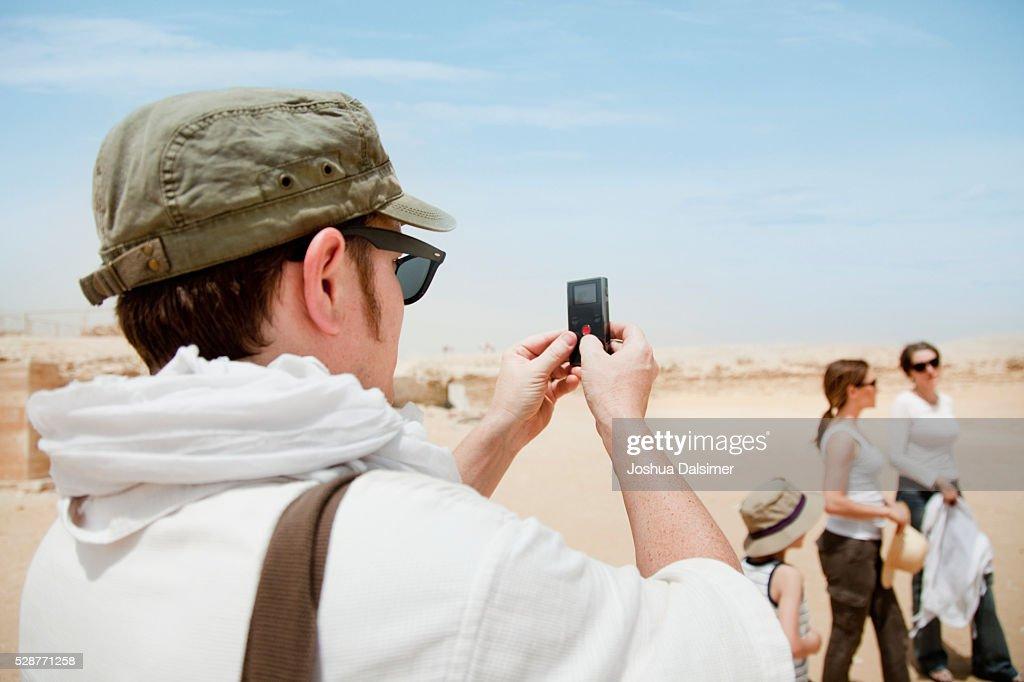 Man photographing women : Stock Photo