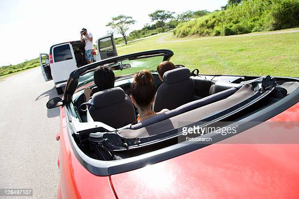 man photographing young people in the car, saipan, usa - 北マリアナ諸島 ストックフォトと画像