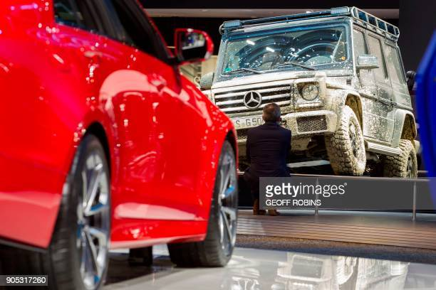 A man photographs a GWagon at the 2018 North American International Auto Show Press Preview in Detroit Michigan on January 15 2018 The Detroit Auto...
