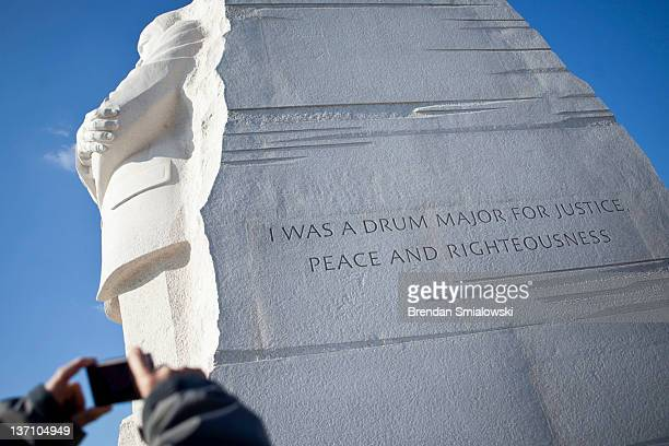 A man photographs a paraphrased quote the National Parks Service plans to remove from the Martin Luther King Jr memorial on the National Mall January...