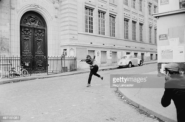 A man photographs a rioter in the Place de la Sorbonne during civil unrest in Paris 12th June 1968