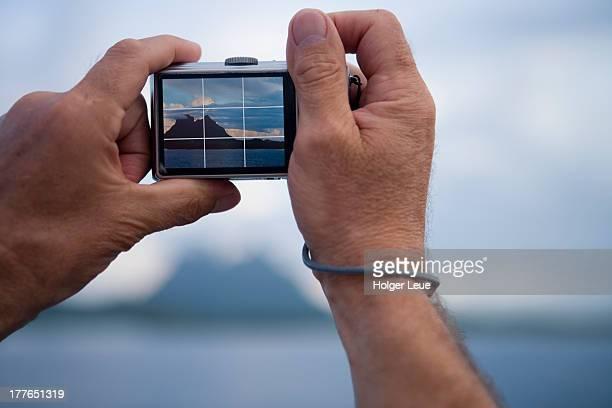 Man photographs Mount Otemanu