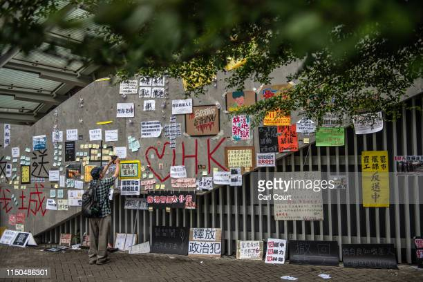 A man photographs protest posters on the wall of a stairway near the Legislative Council building on June 18 2019 in Hong Kong Hong Kongs Chief...