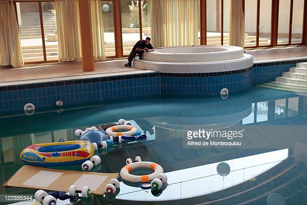 A man photographs the indoor pool in the compound of Aisha Gaddafi's luxury villa on August 27 2011 in Tripoli Libya Houses belonging to the Libyan...