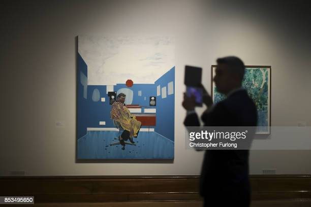 A man photographs work by artist Hurvin Anderson during a press preview for the 2017 Turner Prize at The Ferens Art Gallery on September 25 2017 in...