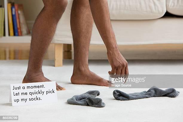 A man picking up socks