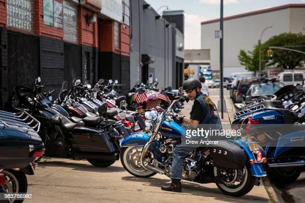 A man picks up his HarleyDavidson motorcycle from the service garage of the HarleyDavidson of New York City showroom store June 25 2018 in the Queens...