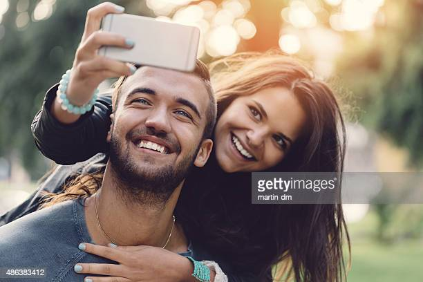 Man piggybacks girl for a selfie