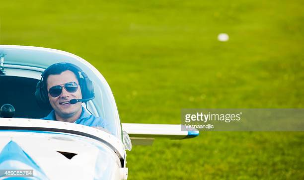 Man pilot looking at sky, preparing for flying