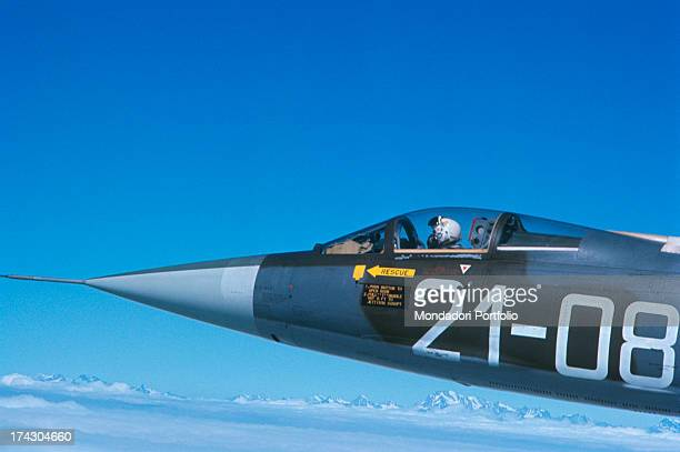 A man piloting an Air Force fighter plane F104 G 1966