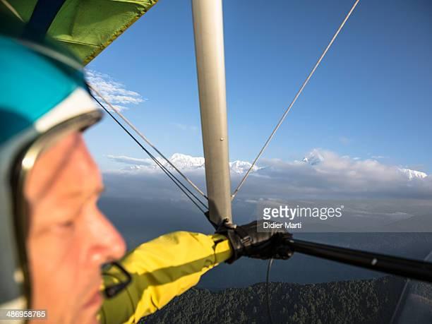 Man pilots an ultra light plane along the Annapurna mountain range in Nepal