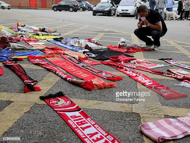Man places a tribute outside Walsall Football Club in memory of, Adrian Evans, Patrick Evans and Joel Richards who were among 38 people who killed in...