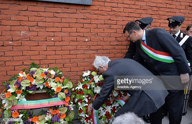 Man places a wreath during a ceremony marking the 30th anniversary of the tragedy at the stadium, renamed King Baudouin Stadium, in Brussels, on May...