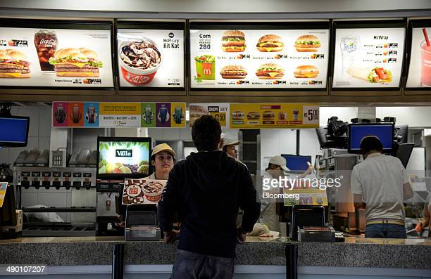 A man places an order at a McDonald's Corp restaurant in Barueri Brazil on Tuesday April 29 2014 After being sued by employees in Brazil who rejected...