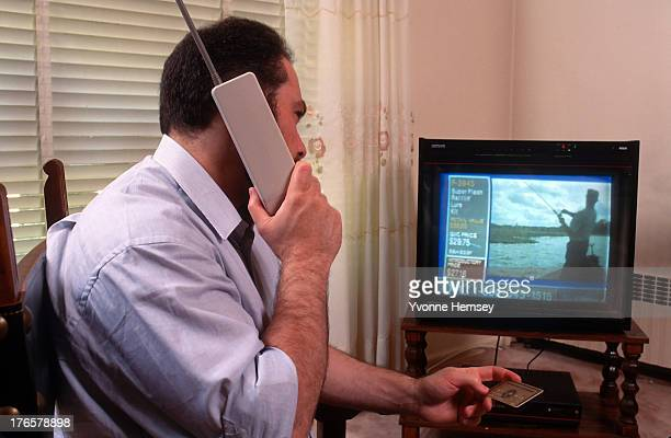 Man places an order with QVC, the television and online retailer, July 1, 1993 in New York City.