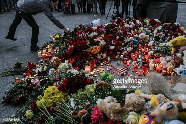 A man places flowers at a memorial for the victims of Airbus A321 crash at the Pulkovo Airport on November 1 2015 in St Petersburg Russia A Russian...