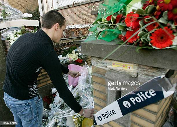 A man places flowers at the entrance of the house of the Mokadem family at the General Jaques Avenue March 2 2007 in Nivelles Belgium The Belgian...