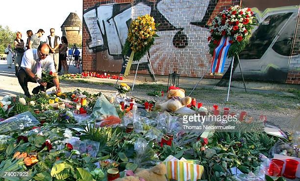 A man places flowers at the scene of a police officer shooting on April 27 2007 in Heilbronn Germany Pedestrians found a murdered female police...