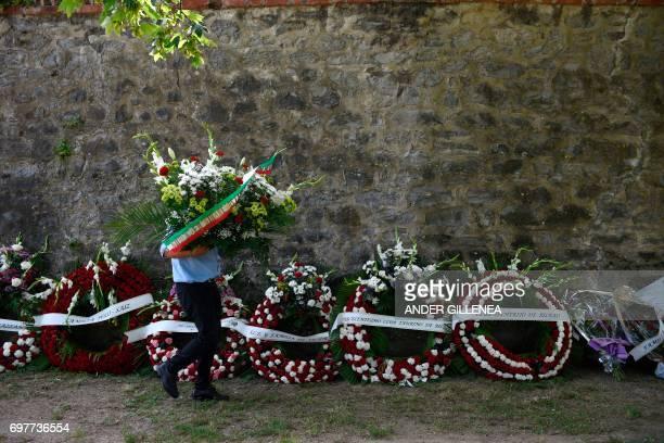 TOPSHOT A man places wreaths around Orduna's bullring to honour Spanish matador Ivan Fandino before his funerals on June 19 2017 Spanish matador Ivan...