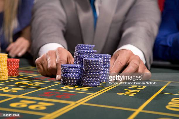 Man placing bet with gambling chips