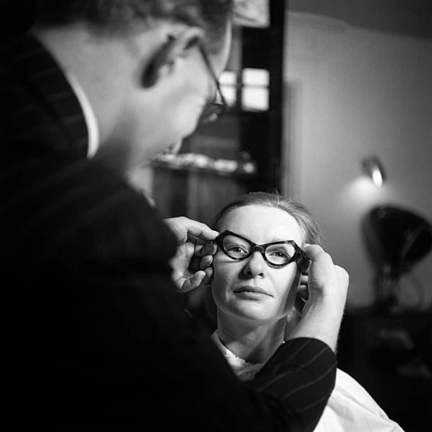 Man Placing Spectacles On Woman (B&W) Wall Art