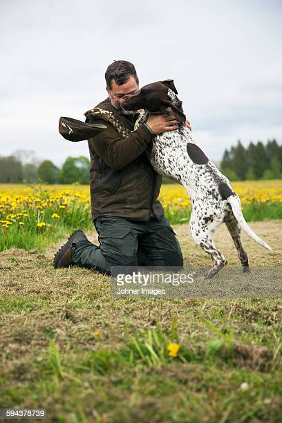 Man plating with dog