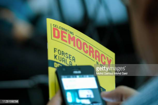 A man play his smartphone during the celebrating democracy in Malaysia marked by Democracy Fest 2019 on February 16 2019 in Kuala Lumpur Malaysia...