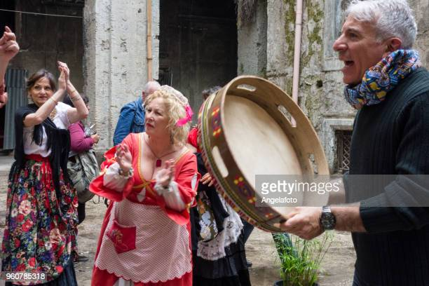 Man Playing a Drumer and Singing in a street of Naples, Italy
