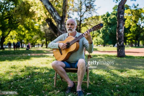 man playing a guitar - classic rock stock pictures, royalty-free photos & images