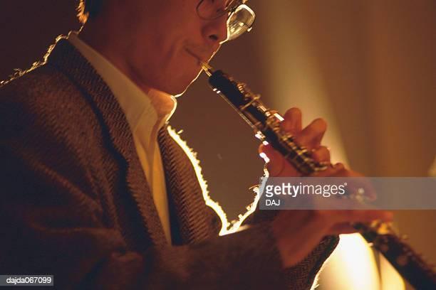 man playing a oboe - oboe stock-fotos und bilder