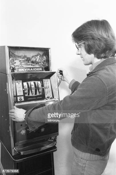 Man playing a one arm bandit slot machine in a London amusement arcade 8th January 1975