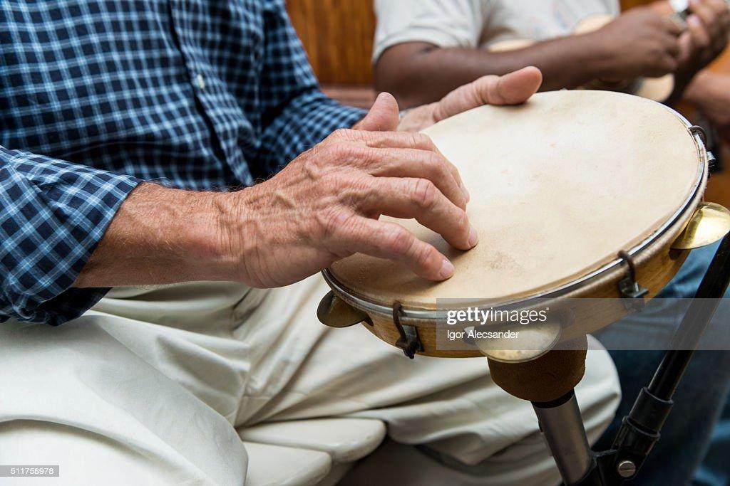 Man playing a pandeiro (tambourine) in a Chorinho music concert, Brazil : Stock Photo