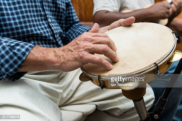 Man playing a pandeiro (tambourine) in a Chorinho music concert, Brazil