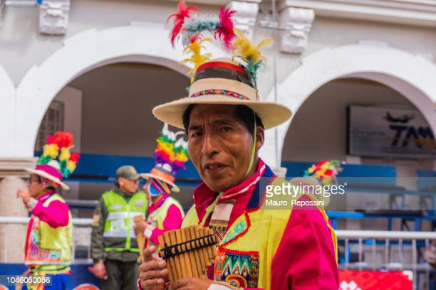 Man playing a panpipe at Oruro Carnival in Bolivia.