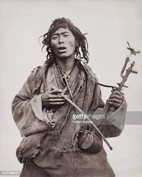 A man playing a singlestringed fiddle Darjeeling Himalayan hill region West Bengal India circa 1875 Vintage albumen print Attributed to Sir Benjamin...