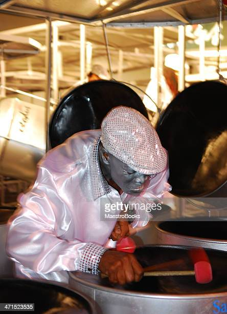 man playing a steel drum. - steel drum stock photos and pictures