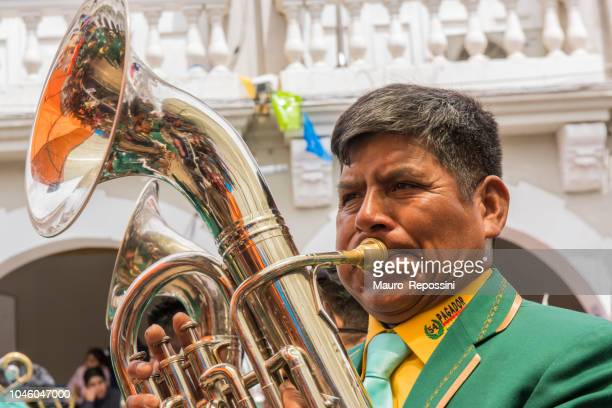 Man playing a tuba at Oruro Carnival in Bolivia.