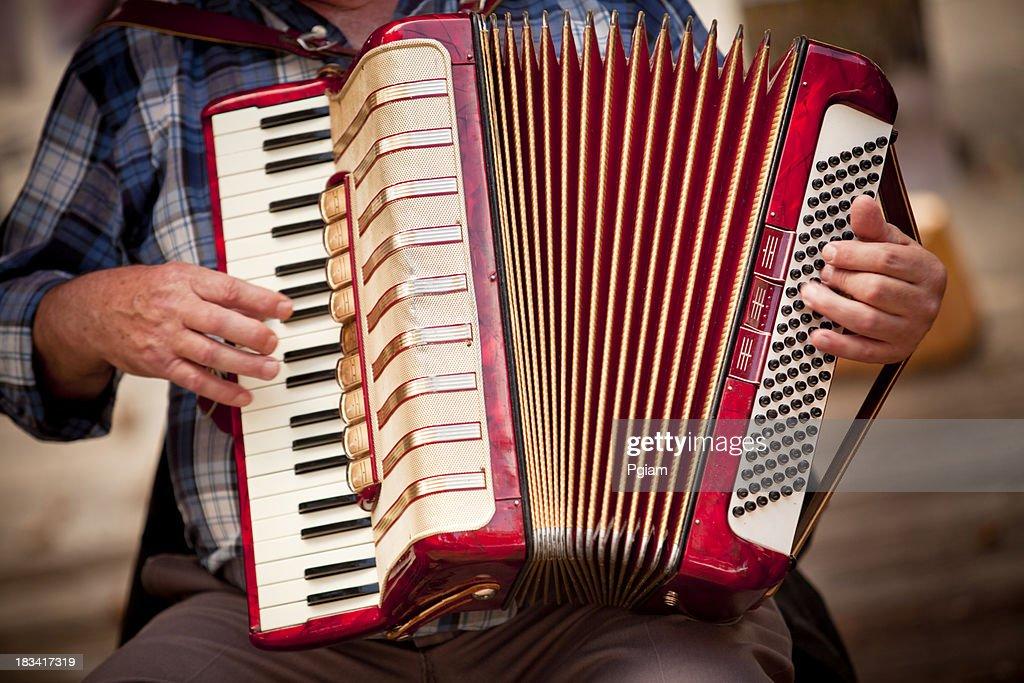 Man playing accordian : Stock Photo