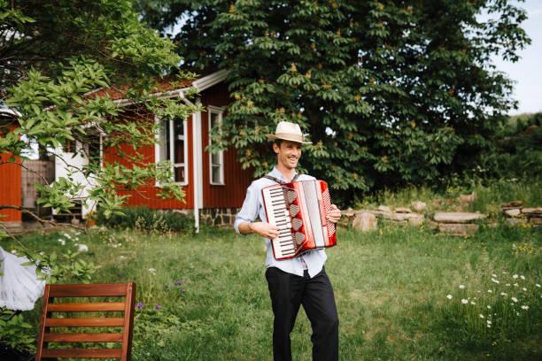 Man playing accordion in garden