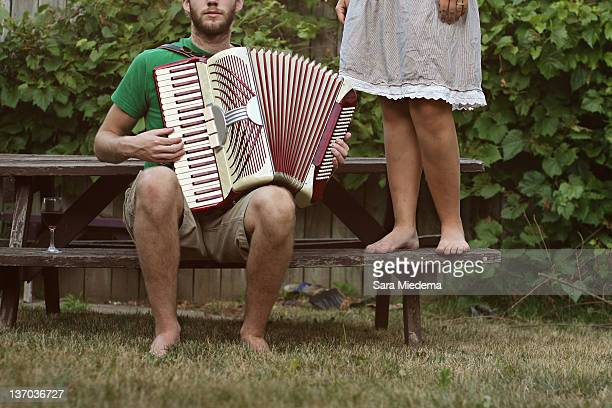 man playing accordion - hamiltonmusical stockfoto's en -beelden