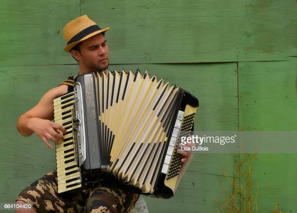 man playing accordion - new orleans stock pictures, royalty-free photos & images